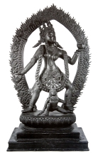 Kali dancing the Cosmic dance, with awestruck girl at her feet. Stone sculpture, Gujarat, 16th century.